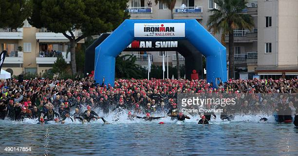 Participants compete in the swim leg of the race during Ironman Mallorca on September 26 2015 in Palma de Mallorca Spain