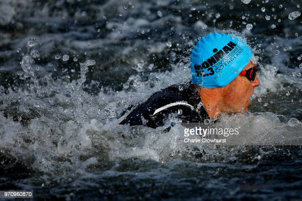 Participants compete in the swim leg of the race during the IRONMAN 70.3 Staffordshire on June 10, 2018 in Lichfield, England.