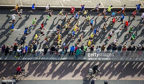Participants compete on the Erasmusbrug during the Rotterdam Marathon in Rotterdam on April 12 2015 AFP PHOTO / ANP / MARCO DE SWART netherlands out