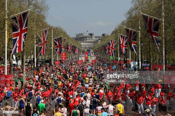 Participants congregate along The Mall during the 2018 London Marathon in central London on April 22 2018