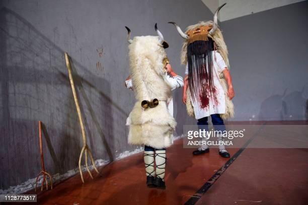 Participants covered in cow blood and wearing Momotxorro costumes take part in the Alsasua carnival in the northern Spanish village of Alsasua in...