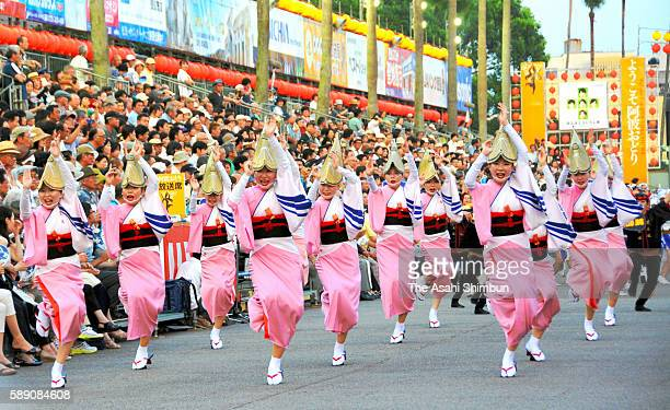 Participants dance as the Awa Odori dance festival begins on August 12 2016 in Tokushima Japan