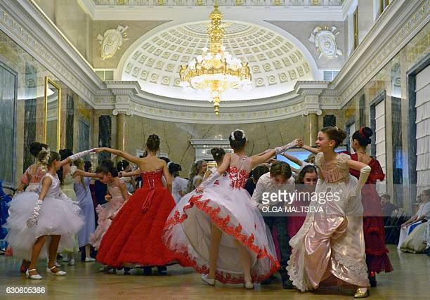 TOPSHOT Participants dance during a Christmas ball in Saint Petersburg on December 27 2016 Cadets of the Naval Academy and of the Suvorov Military...