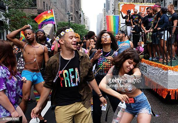 Participants dance during the 2015 New York City Pride march in New York on June 28, 2015. Under a sea of rainbow flags, hundreds of thousands of...