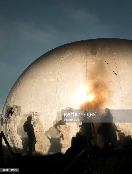 Participants dance in a giantic bubble at the 31st annual Chaos Communication Congress on December 28 2014 in Hamburg Germany The annual congress is...