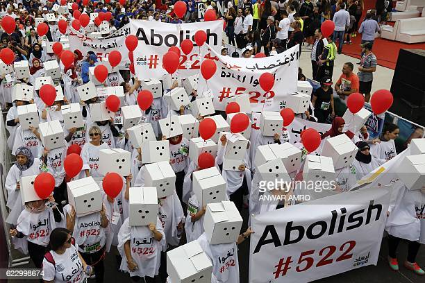 Participants demanding the abolishment of article 522 of Lebanon's Penal code take part in the 14th annual Beirut Marathon on November 13 2016 in the...