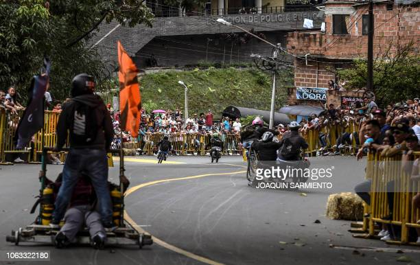 Participants descend a hill in homemade vehicles during the 29th Car Festival in Medellin Antioquia department Colombia on November 18 2018