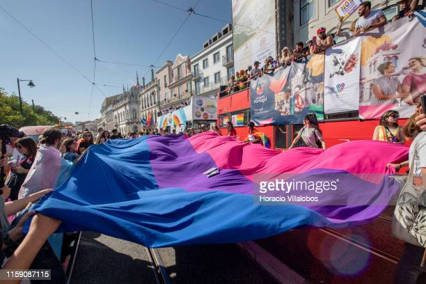 Participants display a bisexual pride flag while marching from Jardim do Príncipe Real to Ribeira das Naus during the 20th LGBTI parade on June 29...