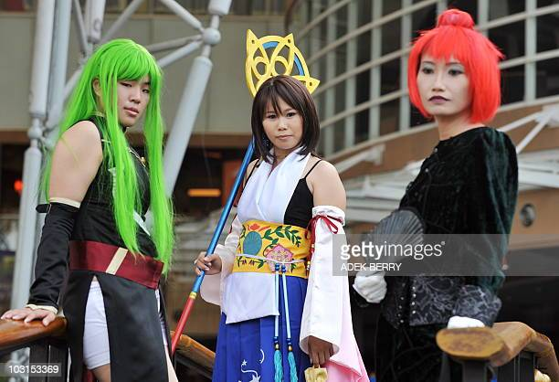 Participants dress up as Japanese Manga characters during a Halloween costume competition to celebrate Halloween day in Jakarta on October 31 2009...