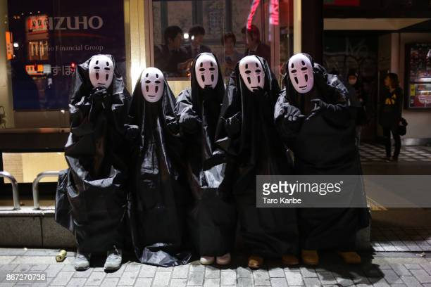 Participants dress up as Kaonashi on the Halloween weekend in Shibuya district on October 28 2017 in Tokyo Japan