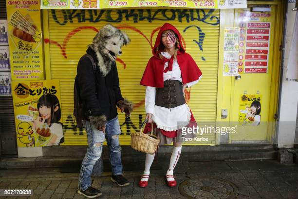 Participants dress up as Little Red Riding Hood and wolf on the Halloween weekend in Shibuya district on October 28 2017 in Tokyo Japan