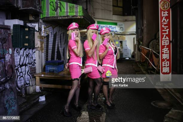 Participants dress up as Pink Police on the Halloween weekend in Shibuya district on October 28 2017 in Tokyo Japan