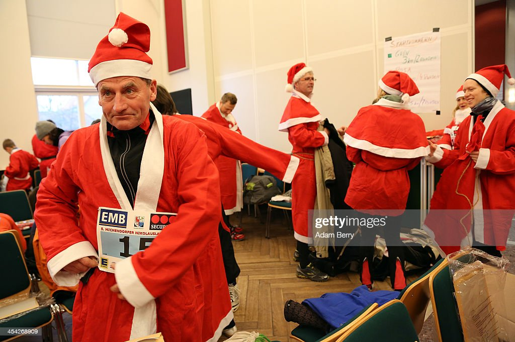 Participants dress up as Santa Claus prior to competing in the 5th annual Michendorf Santa Run (Michendorfer Nikolauslauf) on December 8, 2013 in Michendorf, Germany. Over 900 people took part in this year's races, which included one for children and one for adults.