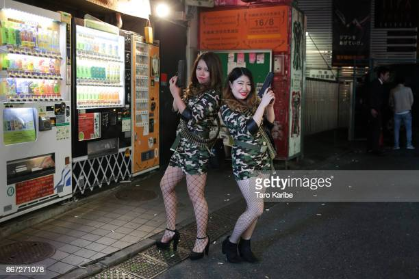 Participants dress up as soldiers on the Halloween weekend in Shibuya district on October 28 2017 in Tokyo Japan