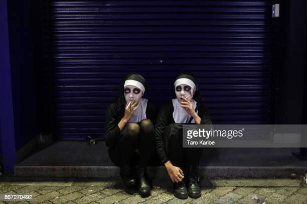 Participants dress up as Zombie sisters on the Halloween weekend in Shibuya district on October 28 2017 in Tokyo Japan