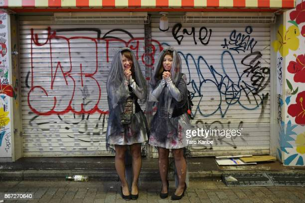 Participants dress up as Zombiebrides on the Halloween weekend in Shibuya district on October 28 2017 in Tokyo Japan