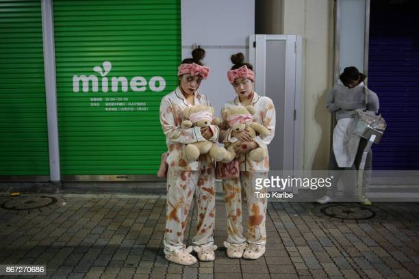 Participants dress up as Zombies in pajamas on the Halloween weekend in Shibuya district on October 28 2017 in Tokyo Japan