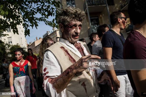 Participants dressed and made up as zombies take part in the 11th edition of the Zombie Walk in the streets of Lyon France September 23 2017