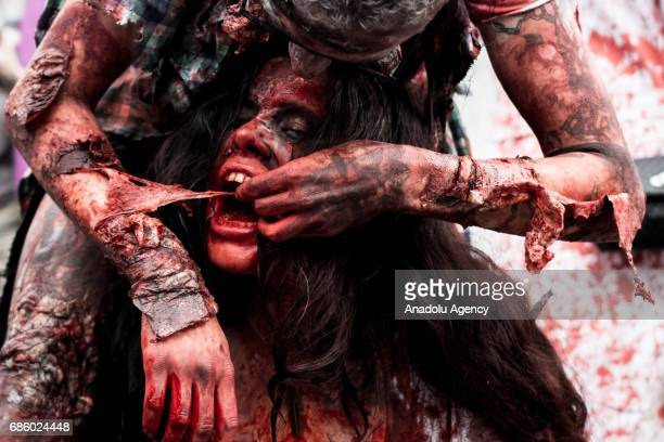 Participants dressed and made up as zombies take part in the Zombie walk in Prague Czech Republic on May 20 2017 Prague's Zombie Walk with people...