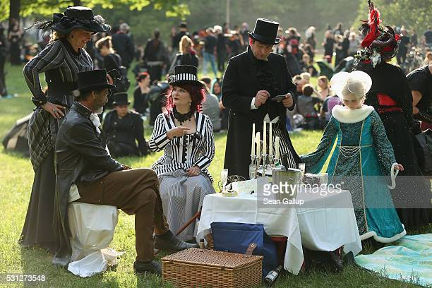 Participants dressed appropriately attend the Victorian Picnic on the first day of the annual WaveGotikTreffen music festival on May 13 2016 in...