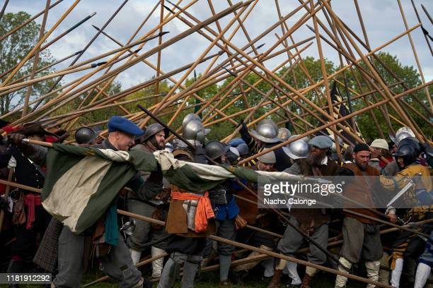 Participants dressed as a battalion of picketers rehearse before the performance of the battle on October 18 2019 in Groenlo Netherlands For three...