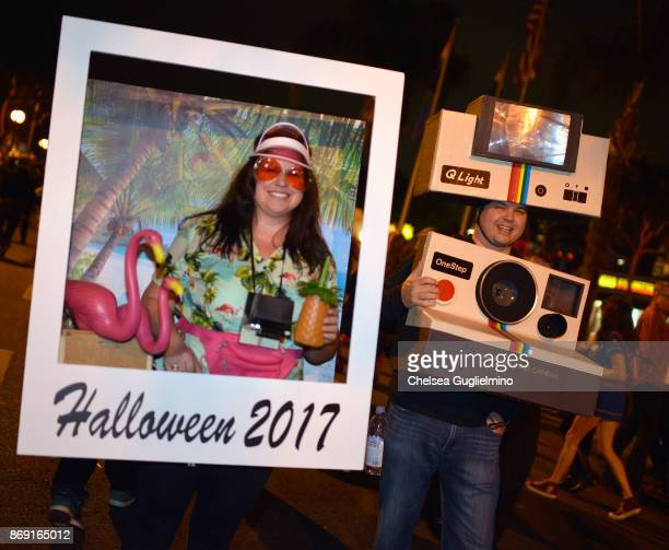 Participants dressed as a Polaroid camera and photograph attend the West Hollywood Halloween Carnaval on October 31 2017 in West Hollywood California