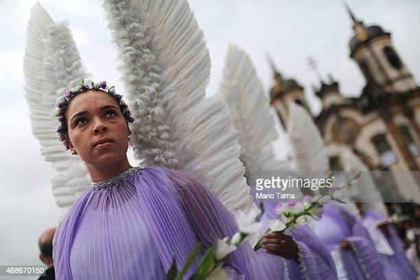 Participants dressed as angels march in the annual Easter procession during traditional Semana Santa festivities on April 5 2015 in Ouro Preto Brazil...