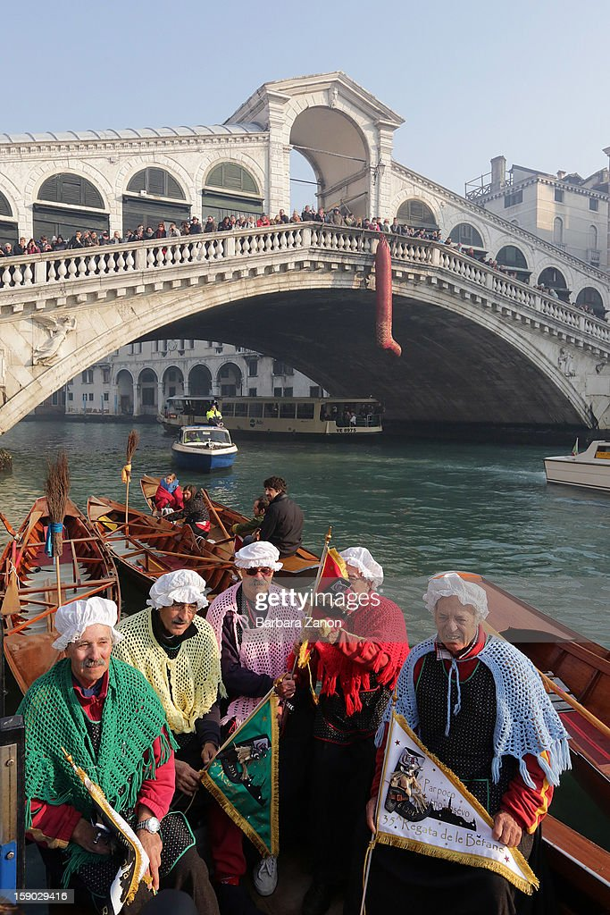 Participants dressed as 'Befana' pose for photographers on Gran Canal during the traditional Epiphany Boat Race on January 6, 2013 in Venice, Italy. In Italy, Epiphany is celebrated on January 6, and on the canal mascareta boats are piloted in tribute to 'Befana', a witch who delivers gifts and sweets to children.