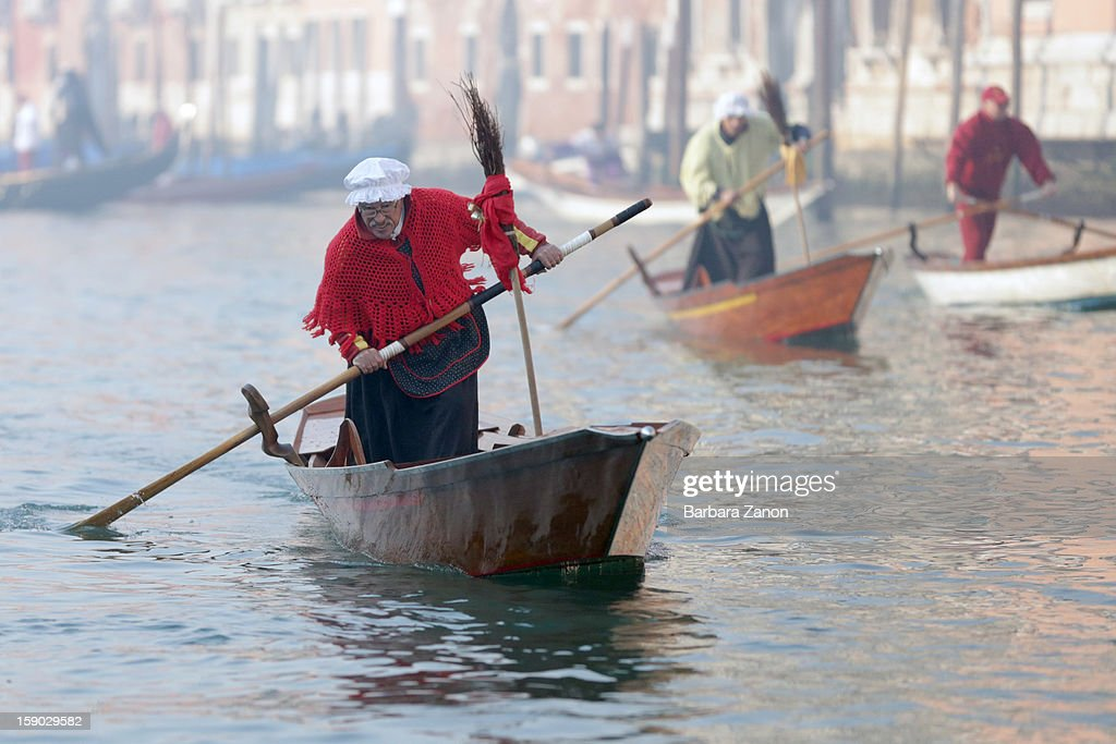 Participants dressed as 'Befana' row on Gran Canal during the traditional Epiphany Boat Race on January 6, 2013 in Venice, Italy. In Italy, Epiphany is celebrated on January 6, and on the canal mascareta boats are piloted in tribute to 'Befana', a witch who delivers gifts and sweets to children.