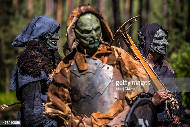 Participants dressed as characters from The Hobbit book by J R R Tolkien wait for the reenactment of the Battle of Five Armies in a forest on June 6...