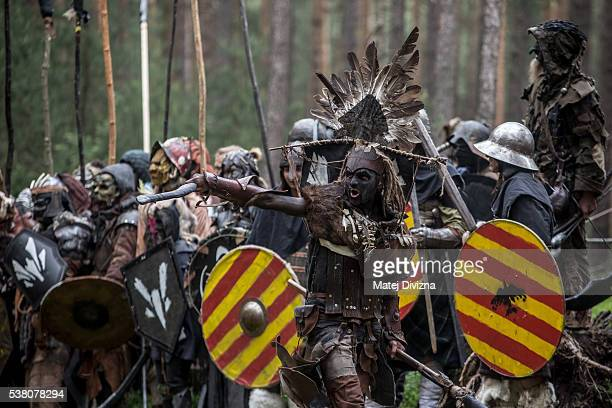 Participants dressed as characters from 'The Hobbit' book by J. R. R. Tolkien take part in the reenactment of the 'Battle of Five Armies' in a forest...