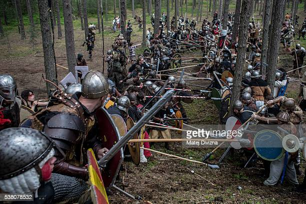 Participants dressed as characters from 'The Hobbit' book by J R R Tolkien take part in the reenactment of the 'Battle of Five Armies' in a forest on...