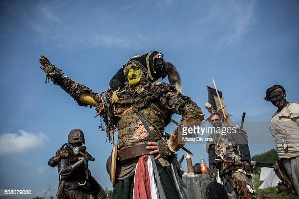 Participants dressed as characters from 'The Hobbit' book by J R R Tolkien prepare for the reenactment of the 'Battle of Five Armies' in a forest on...