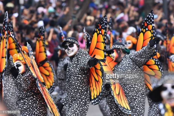 Participants dressed as monarch butterfly take part during the commemorative 'Day of the Dead International Parade' as part of celebrations of the...