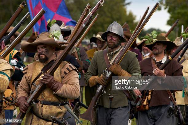 Participants dressed as musketeers of the Dutch army on march October 18 2019 in Groenlo Netherlands For three days the streets of the village of...