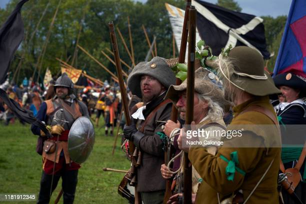 Participants dressed as musketeers of the Dutch army stand by on October 18 2019 in Groenlo Netherlands For three days the streets of the village of...
