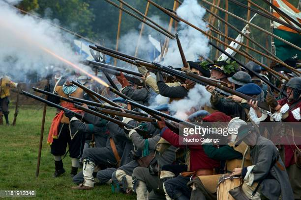 Participants dressed as musketeers of the United Provinces army fire blanks on October 18 2019 in Groenlo Netherlands For three days the streets of...