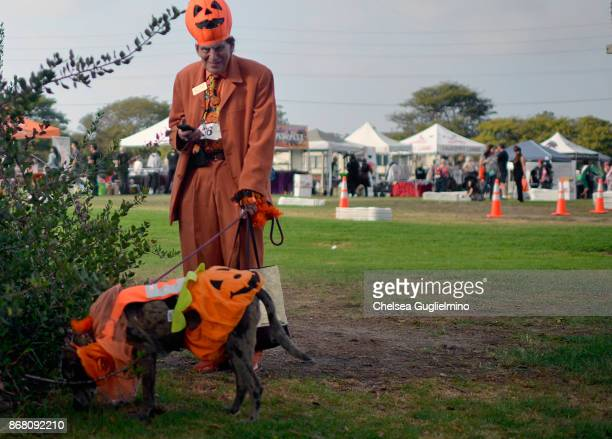 Participants dressed as pumpkins seen at the Haute Dog Howl'oween Parade on October 29 2017 in Long Beach California