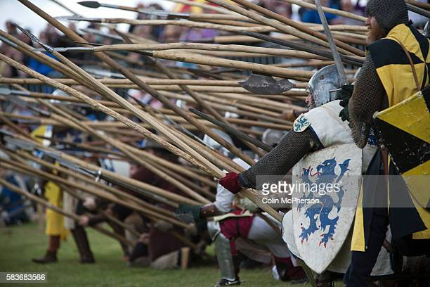 Participants dressed as Scottish soldiers taking part in a battle scene at Bannockburn Live at Bannockburn Stirlingshire The reenactment marked the...