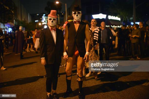 Participants dressed as skeletons at West Hollywood Halloween Carnaval on October 31 2017 in West Hollywood California