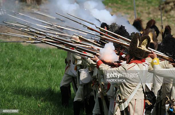 Participants dressed as soldiers of the First French Empire fight during the reenactment of a Napoleonic military battle that took place in 1805 at...