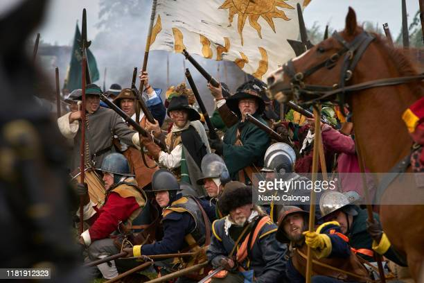 Participants dressed as soldiers of the United Provinces army before the charge of the Spanish cavalry on October 18 2019 in Groenlo Netherlands For...