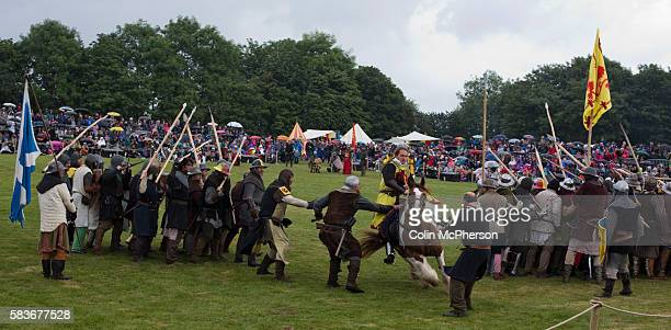 Participants dressed as soldiers taking part in a battle scene at Bannockburn Live at Bannockburn Stirlingshire The reenactment marked the 700th...