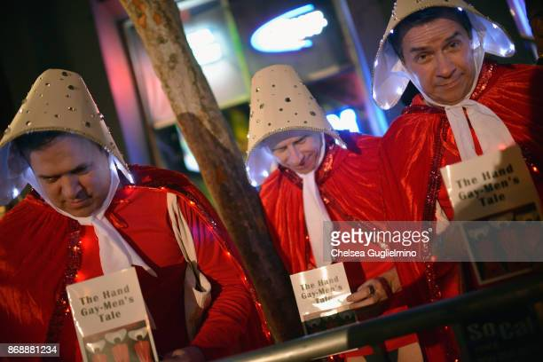 Participants dressed as The Hand GayMen's Tale at West Hollywood Halloween Carnaval on October 31 2017 in West Hollywood California