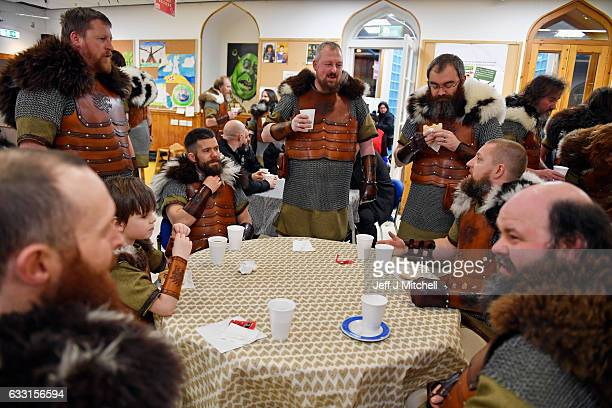 Participants dressed as Vikings eat breakfast as they prepare to participate in the annual Up Helly Aa festival on January 31 2017 in Lerwick...
