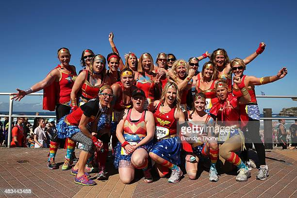 Participants dressed as 'Wonder Woman' pose after completing the 2015 City To Surf race on August 9 2015 in Sydney Australia