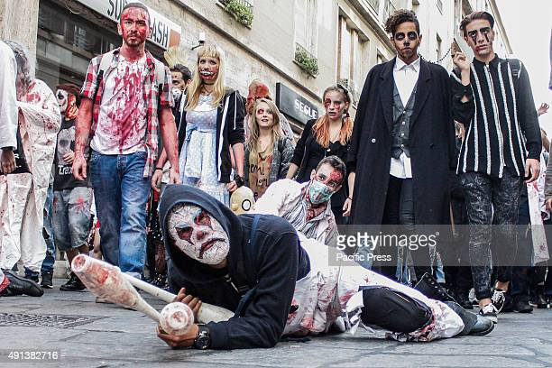 Participants dressed as zombies join in with the Torino Zombie Walk which was attended by hundreds of people in the streets of Turin