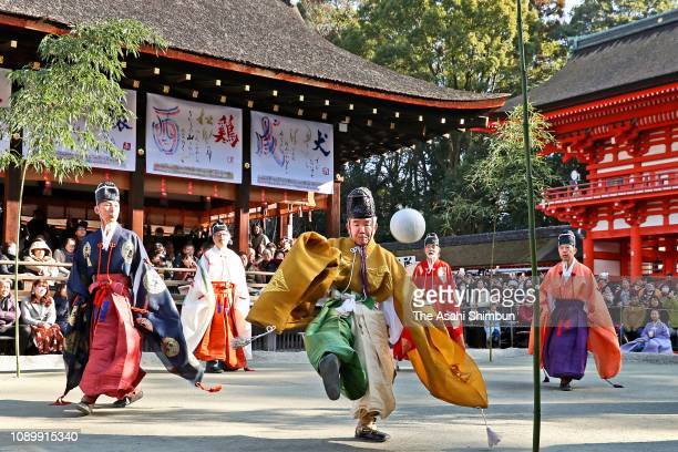 Participants dressed in colourful costumes play 'Kemari' at the Shimogamo shrine on January 4, 2019 in Kyoto, Japan. Kemari was popular in Japan...