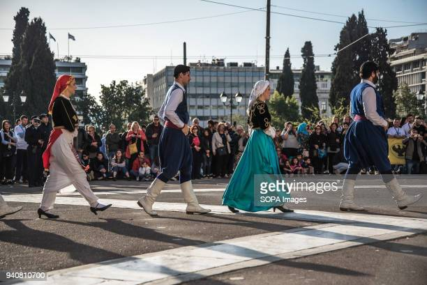 Participants dressed in Greek traditional outfits seen dancing in front of the Greek Parliament A total of 350 young people from all over the world...