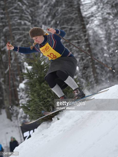 Participants dressed in old-fashioned clothes take part in a 'Nostalski' skiing session in Kruen, Germany, 07 January 2017. Photo: Angelika...